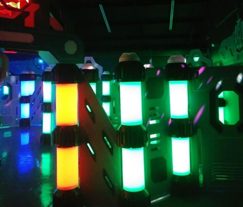 Immersive & interactive laser tag arena defends itself with A.I. (Features concert-style L.E.D. & laser lighting.)