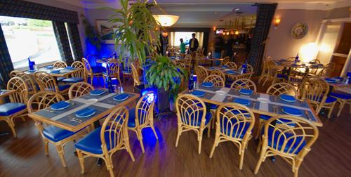 Dine in our Blue Bistro for dinner while looking over the lake.