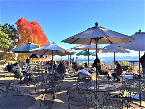 Diners enjoy lunch on the terrace in autumn