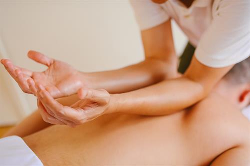 Forearm compression - lomi style - PalmLeaf Massage Clinic
