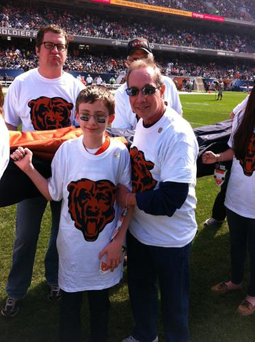 Gabriel & Larry onfield at Bears game