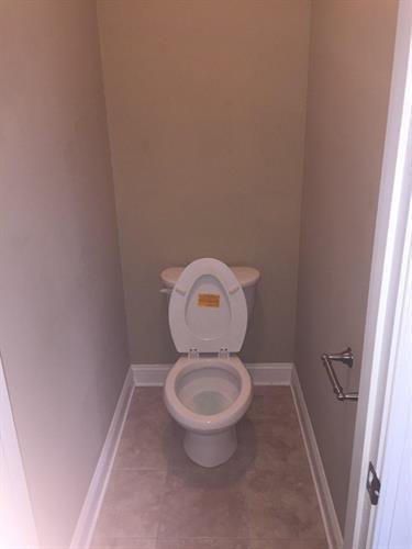 Toilet in master bathroom