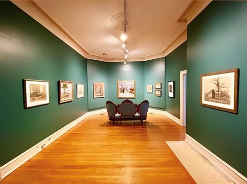 Pops of color have splashed the gallery walls on the Flanagan House portion of the museum to pay homage to its once original state of being a home in the early 1900's.