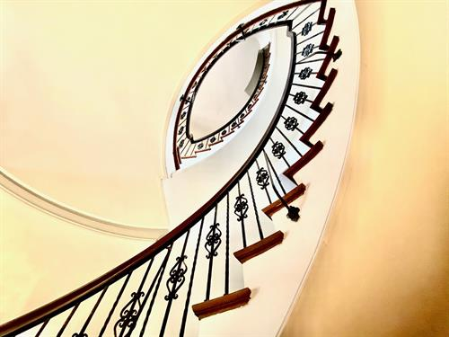 Signature staircase from first floor foyer.
