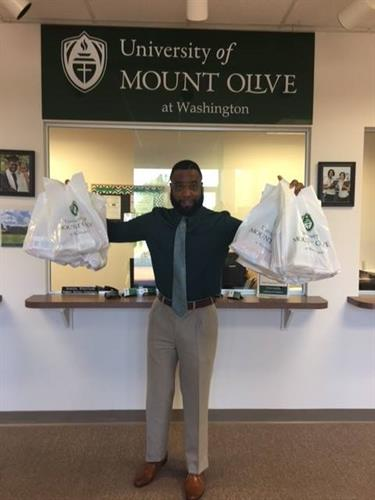 Admission Rep Montez Bishop with donation bags for Hurricane Matthew victims