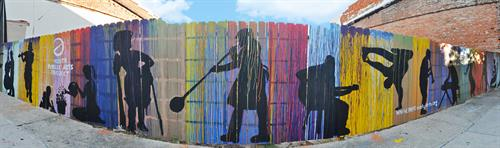Evans Street Fence Mural completed by Youth Public Arts Project