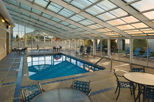 Indoor/Outdoor Pool with Surrounding Courtyard rooms.