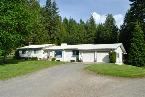For Sale!  40+ acres, year round creek, 3 shops, 2 garden sheds, & A Home!