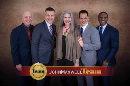 Mickey Quinn with faculty members of John Maxwell Team