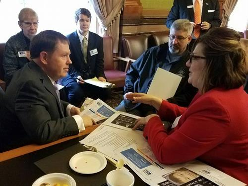 President/CEO, Danielle Peterson at the United Way Day on the Hill, speaking with legislators about needs related to brain health, homelessness, and food scarcity.