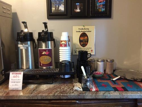 Local coffee and fresh muffins greet guests each morning in the common area.