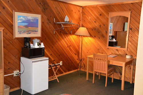 All guest rooms have a refrigerator, microwave oven, coffee maker, tv, plus desk and chair.