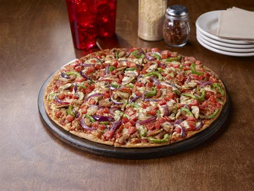 NEW - The Edge Pizza where all toppings reach to the very edge of the pizza.