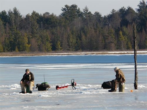 Ice fishing on a cranberry marsh