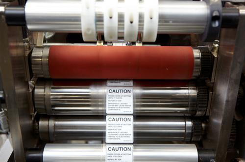 A TLP flexographic narrow web printing press in action.