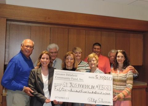 Receiving grant award from Greater Delafield Community Fund