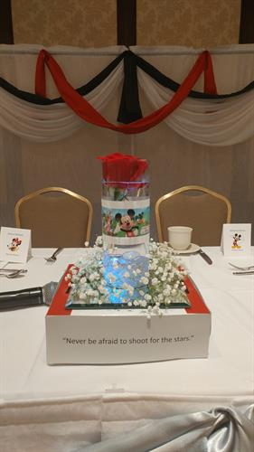 Backdrop and custom centerpiece for the bride and groom