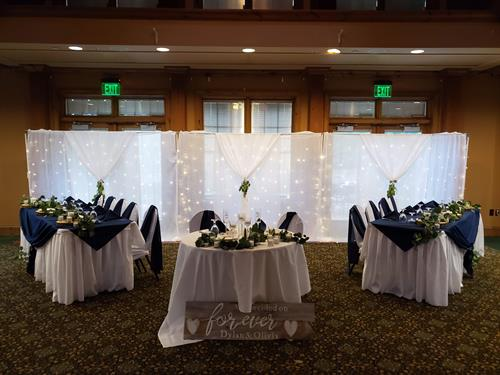 Head table backdrop, table linens, and decor