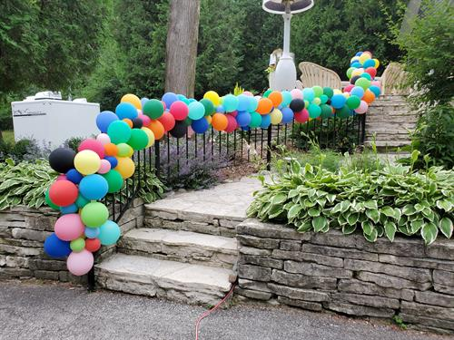 Walkway adorned with pops of color make a grand entrance