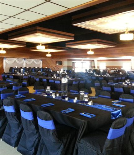 Black and Royal Blue linens really pop with a table glowing with candle centerpiece
