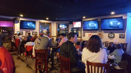 Plenty of TV's and seating in DJ's Sports Bar!