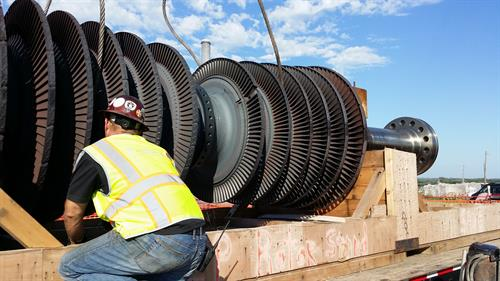 Green Industrial loading a main steam turbine shaft during Power Plant work