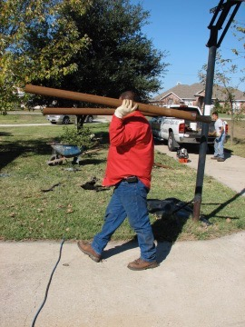 Granite Foundation Repair worker carrying Steel for Steel Piling