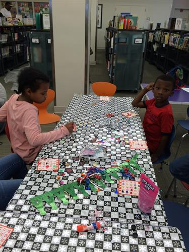 "Playing bingo, decorating hats and making ""Shakers"" for the celebration at Central Library"