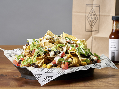Surcheros Nachos - Fresh chips, your favorite toppings & white cheese dip on top