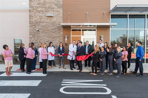 Our ribbon-cutting event included members of the AHCC and the Village of Arlington Heights board members.