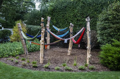 Our Hammock Grove - an ICLA Excellence in Landscape Award Winner - replaced a playset with an older kid hangout.
