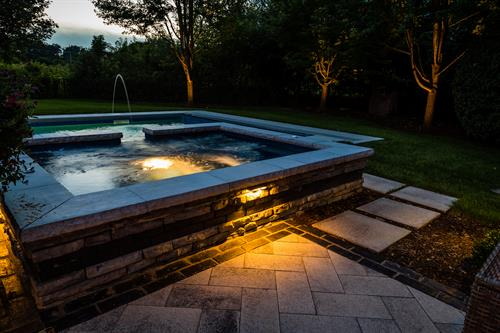 A beautiful wrap around this hot tub - including recessed lighing - makes it an inviting spot, day or night.