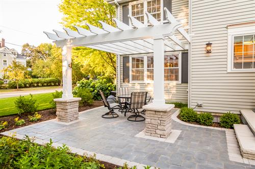 We replaced a small, awkward deck with this open, inviting patio and pergola.