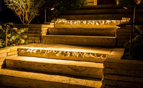 Soft lights on solid ledgestone steps interspersed with landings provide a much friendlier and safer alternative to the steep steps we replaced.