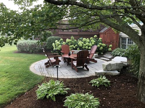 An intimate seating area nestled into the landscape creates a relaxing retreat.