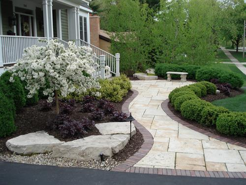 Lush plantings give this updated front walk a ton of curb appeal.