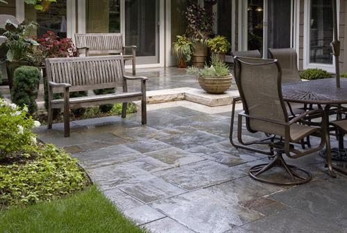 Natural bluestone is a perfect choice for this seen-from-every-room patio.