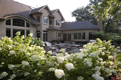 Hydrangeas frame the made-for-entertaining patio.