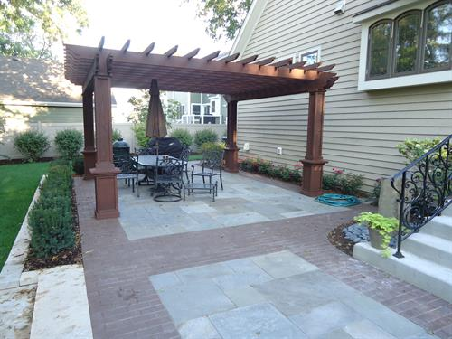 Bluestone, clay pavers, and a custom pergola - a few of our favorite things!