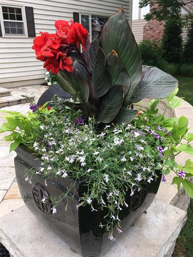 Summer urns are a snap when Bruss does the designing and planting for you.