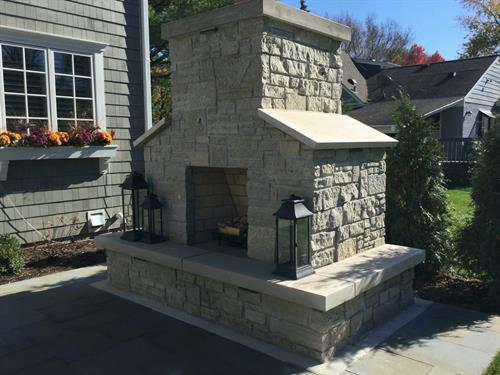 This stone masonry fireplace is a showstopper in this backyard.