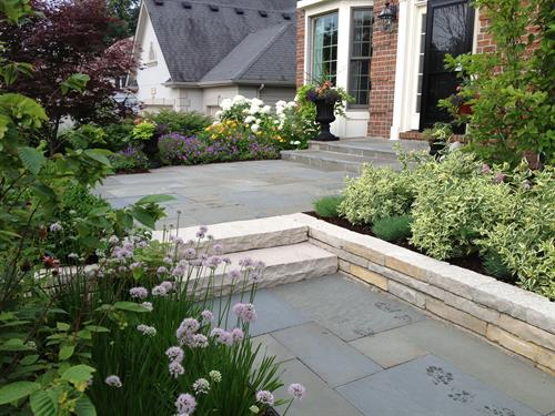 Stunning plants and beautiful hardscape create a welcoming entry.