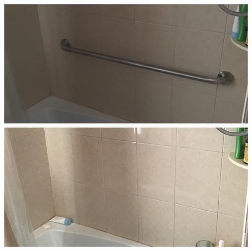 Install grab bars in bathtub in bathroom