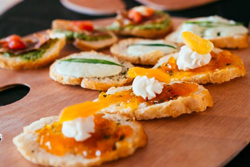 Apricot and Goat Cheese, Smoked Whitefish and Crispy Proscuitto Crostini