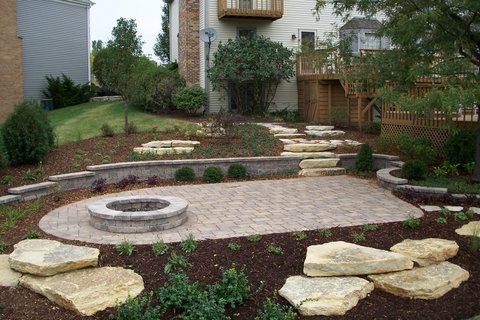 Patio, fire pit and outcropping stone