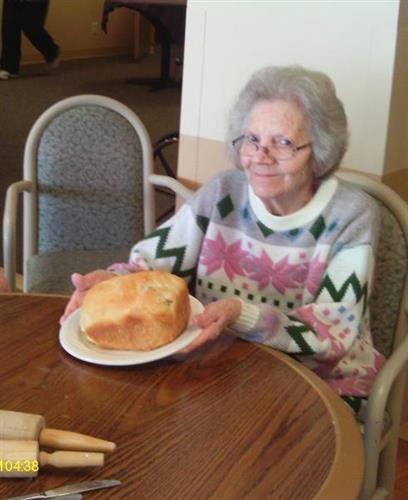 Gallery Image Neva%20holding%20the%20bread%20the%20residents%20made%20in%20a%20baking%20activity.JPG