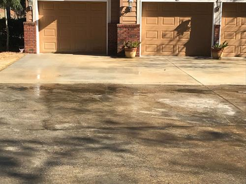 Driveway pressure wash in process (before and after)