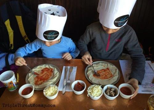 """Family friendly! We offer """"Make Your Own"""" options for the kiddos! Bring them in to create their own pizzas or pretzels! Chefs hats are included of course!"""