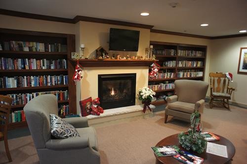 Library with cozy fireplace
