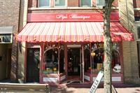 Look for the BRIGHT pink awning!